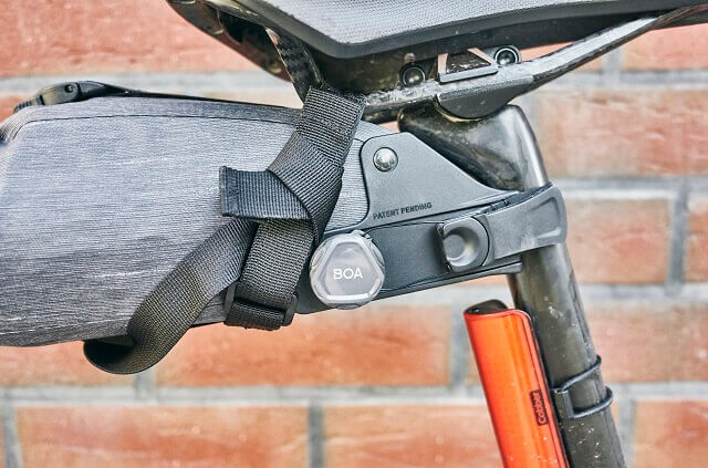 The BOA closure system holds the EVOC bicycle bags firmly in place