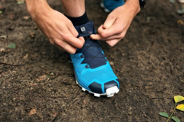 The quicklace tab on the Salomon trail running shoes makes it easy to store the laces