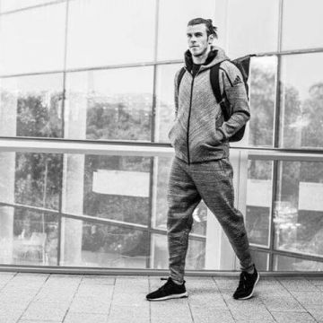 The @adidas Z.N.E. travel hoodie is for all athletes to find and keep their focus on the way to the ...